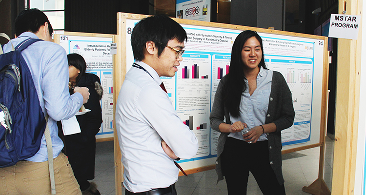 Medical students view research posters