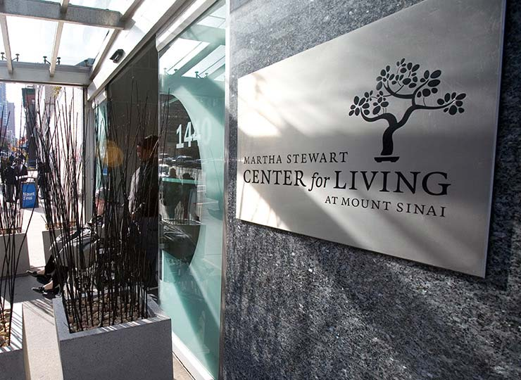Gray sign on granite wall announcing the Martha Stewart Center for Living at Mount Sinai