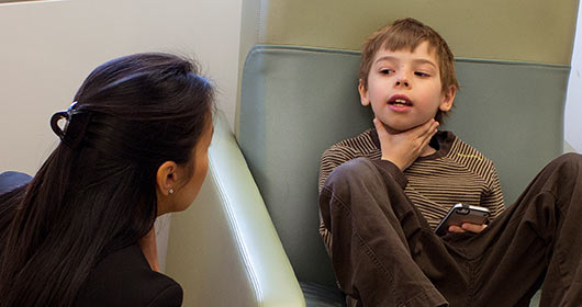 child talking to doctor