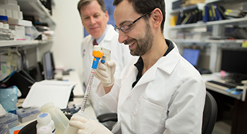 Image of two male researchers in lab