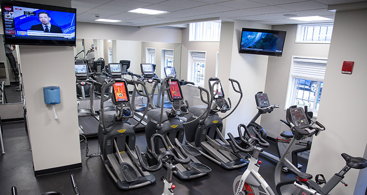 Stationary bicycles and elliptical machines in Aron Hall health fitness room