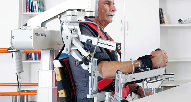 Patient using robotic upper limb