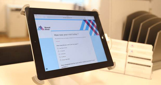 "Tablet with ""How was your visit today?"" on screen display"