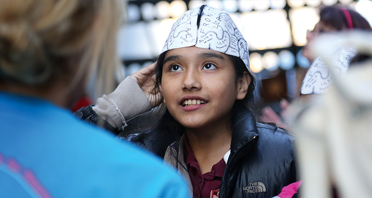 Image of young girl with brain hat