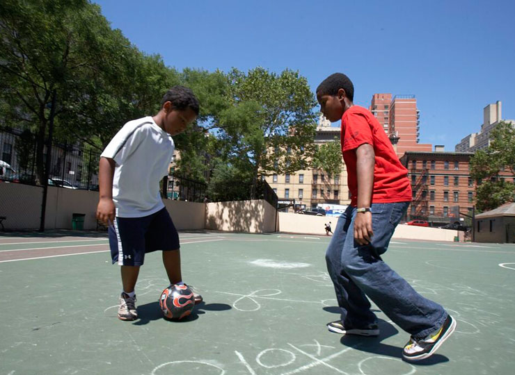 Boys with ball on concrete court