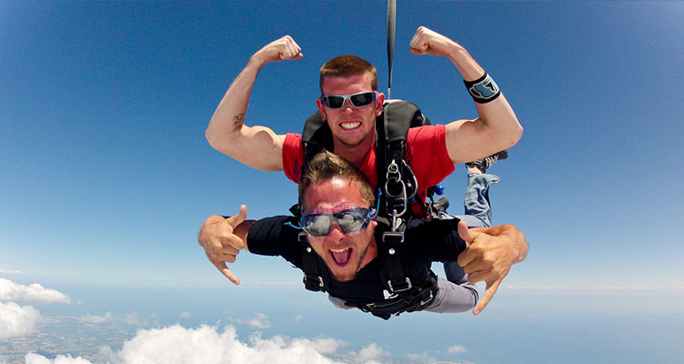 Two males skydiving together